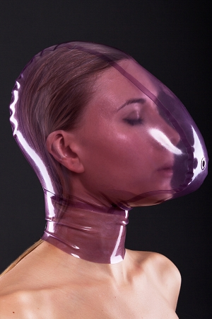 Latex ecstasy mask with a small hole for breath control